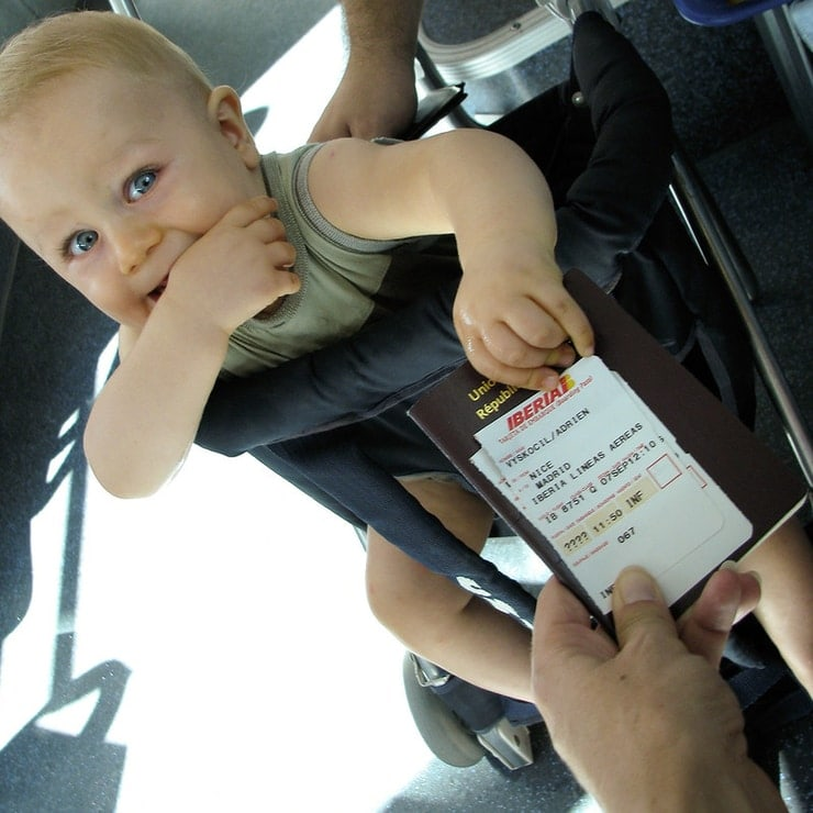 baby flying with documents