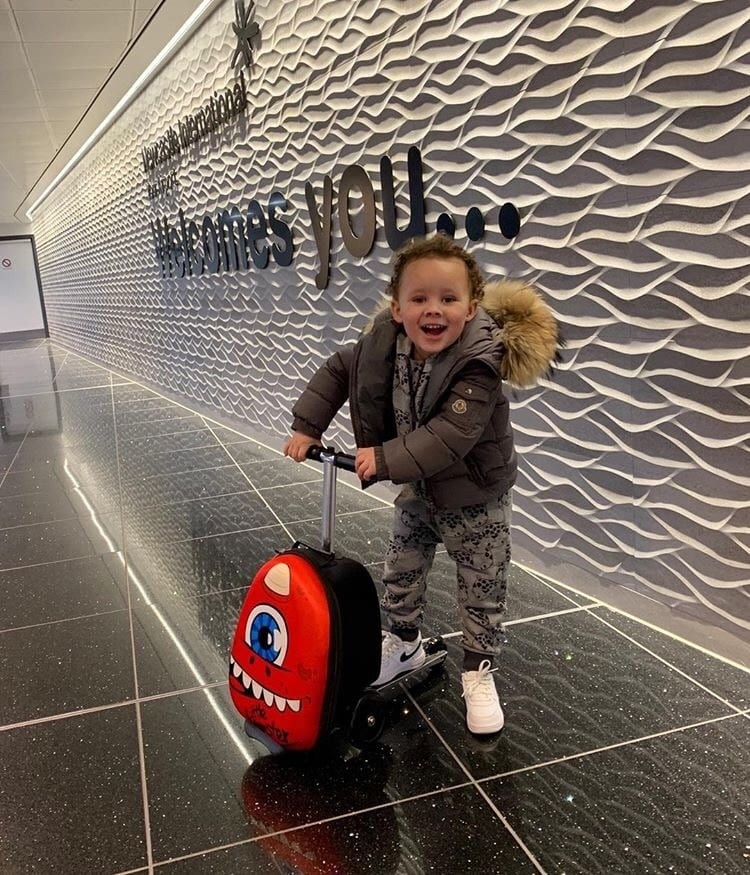 happy kid at the aiport