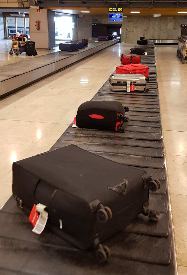 luggages on carousel at airport